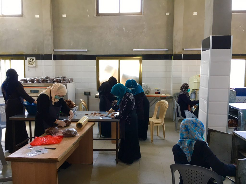 Women processing dates for sale in Gaza